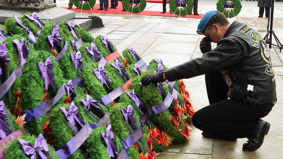 An unidentified veteran pauses as he lays a wreath at the National Remembrance Day ceremony in Ottawa on Sunday, November 11, 2012. (Fred Chartrand / THE CANADIAN PRESS)