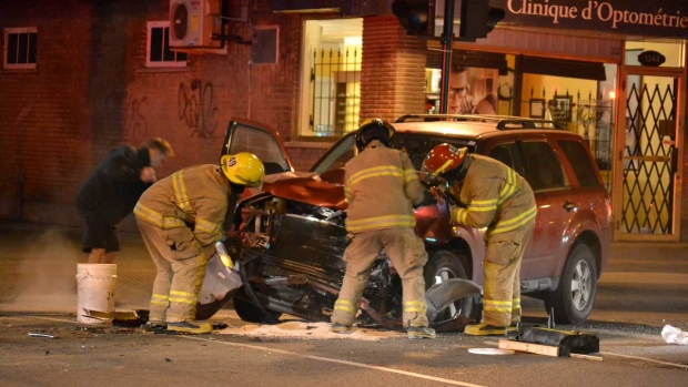 First-responders clean up after a crash on Jean-Ta