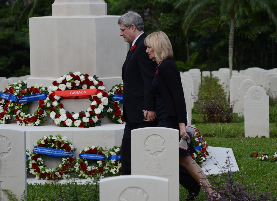 Prime Minister Stephen Harper and wife Laureen Harper take part in a Remembrance Day ceremony at Sai Wan War Cemetery in Hong Kong on Sunday, Nov. 11, 2012. (Sean Kilpatrick / THE CANADIAN PRESS)