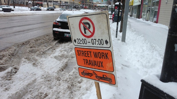 These signs were erected on Portage Avenue Sunday evening after 25 centimetres of snow fell in the city Saturday night.