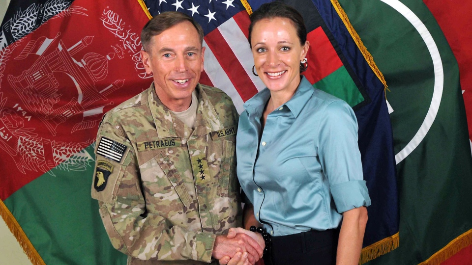 Former Commander of International Security Assistance Force and U.S. Forces-Afghanistan Gen. David Petraeus, left, shaking hands with Paula Broadwell, co-author of 'All In: The Education of General David Petraeus.' (AP / ISAF)