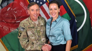 Former Commander of International Security Assistance Force and U.S. Forces-Afghanistan Gen. David Petraeus, left, shakes hands with Paula Broadwell, co-author of 'All In: The Education of General David Petraeus,' July 13, 2011. (ISAF)