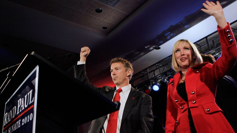 Republican U.S. Senate candidate Rand Paul and his wife Kelley wave to supporters as they arrive for his victory celebration in Bowling Green, Ky., Tuesday, Nov. 2, 2010. (AP / Ed Reinke)
