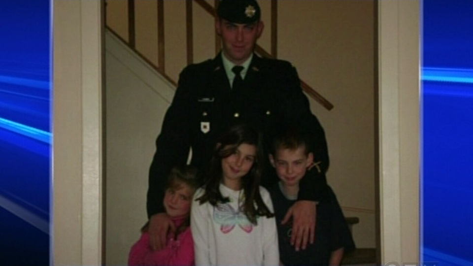 Private John Curwin, who was killed in Afghanistan in 2008, is seen in this photograph along with his three children, who have all received the Memorial Cross, Sunday, Nov. 11, 2012.