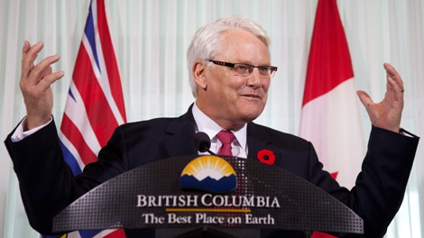 British Columbia Premier Gordon Campbell gestures as he addresses a news conference in downtown Vancouver, Wednesday, Nov 3, 2010. Premier Campbell announced that he will resign as premier. THE CANADIAN PRESS/Jonathan Hayward