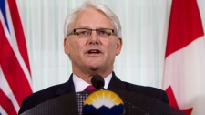 British Columbia Premier Gordon Campbell addresses a news conference in downtown Vancouver, Wednesday, Nov. 3, 2010. (Jonathan Hayward / THE CANADIAN PRESS)