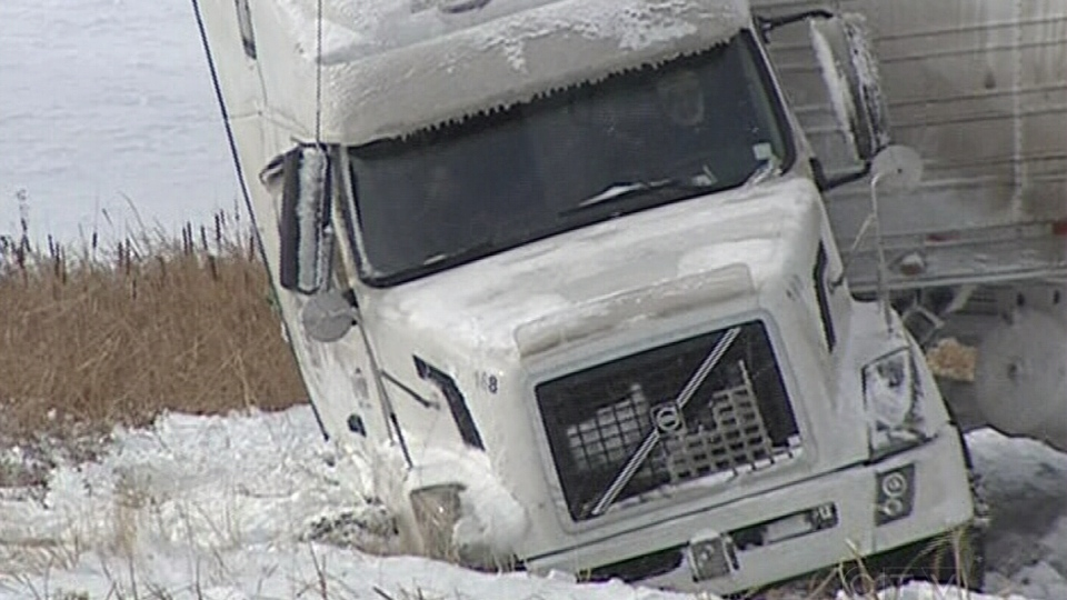 After a semi truck got stuck in a ditch, police closed a major highway near Portage la Prairie, diverting traffic down a sideroad, only to have another semi end up in the ditch on Sunday, Nov. 11, 2012. (CTV Winnipeg)