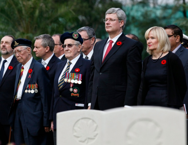 Prime Minister Stephen Harper, accompanied by his wife Laureen, Canadian veterans and officials, attends at a Remembrance Day ceremony at Sai Wan War Cemetery in Hong Kong, Sunday, Nov. 11, 2012. (AP / Kin Cheung)