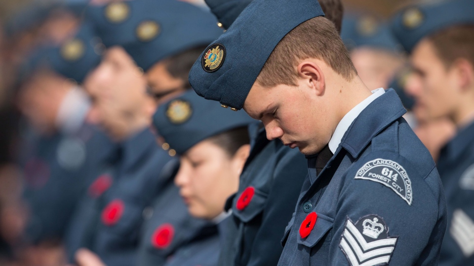 An air cadet bows his head in prayer during Remembrance Day ceremony at the Cenotaph in London, Ontario, Sunday, Nov. 11, 2012. (Geoff Robins / THE CANADIAN PRESS)
