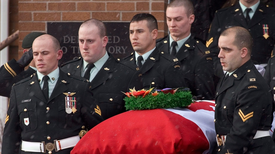 Soldiers carry the casket of Pte. John Michael Roy Curwin from Knox United Church, in Lower Sackville, N.S. on Monday, Dec. 22, 2008. (Andrew Vaughan / THE CANADIAN PRESS)