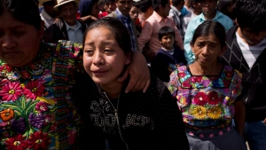 A girl mourns during the funeral procession for the Vasquez family who died when an earthquake struck San Cristobal Cucho, Guatemala, Friday, Nov. 9, 2012. (AP / Moises Castillo)