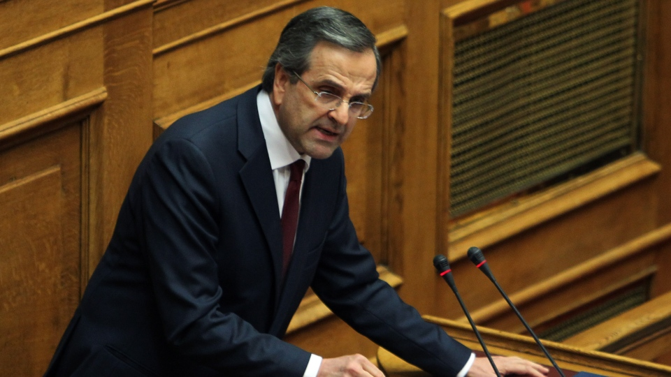 Greece's Prime Minister Antonis Samaras delivers a speech during a parliament meeting for vote on 2013 country's budget in Athens, early Monday, Nov. 12, 2012. (AP / Thanassis Stavrakis)