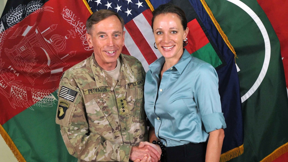 Former CIA director Gen. Davis Petraeus shakes hands with Paula Broadwell, co-author of his biography, July 13, 2011. (International Security Assistance Force)