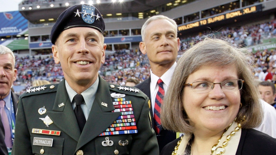 Gen. David Petraeus, commander U.S. Central Command, left, stands with his wife Holly before the NFL Super Bowl XLIII football game between the Arizona Cardinals and the Pittsburgh Steelers in Tampa, Fla., Feb. 1, 2009. (AP / David J. Phillip)