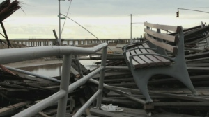This image taken from video shows the scenes of destruction left by Sandy in Rockaway Beach, N.Y.