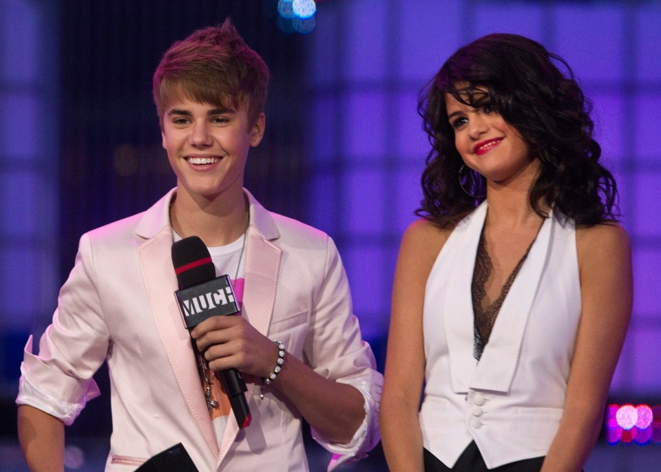 Justin Bieber and Selena Gomez on stage during the 2011 MuchMusic Video Awards in Toronto. (Darren Calabrese / THE CANADIAN PRESS)