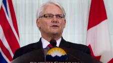 British Columbia Premier Gordon Campbell pauses for a moment as he addresses a news conference in downtown Vancouver, Wednesday, Nov 3, 2010. Premier Campbell announced that he will resign as premier. THE CANADIAN PRESS/Jonathan Hayward
