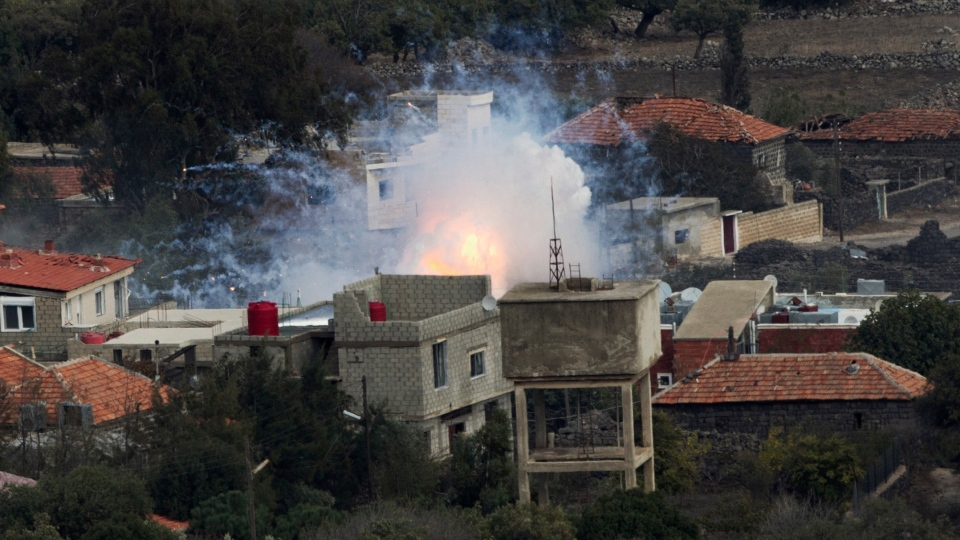 An explosion after shells fired by the Syrian army hit the Syrian village of Bariqa, Monday, Nov. 12, 2012. (AP / Ariel Schalit)