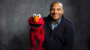 """Sesame Street"" muppet Elmo and puppeteer Kevin Clash in the Fender Music Lodge during the 2011 Sundance Film Festival to promote the film ""Being Elmo"" in Park City, Utah, Jan. 24, 2011. (AP / Victoria Will)"