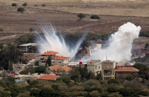 Smoke rises after shells fired by the Syrian army explode in the Syrian village of Bariqa, Monday, Nov. 12, 2012. (AP / Ariel Schalit)