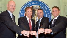 Four new Hockey Hall of Fame inductees pose