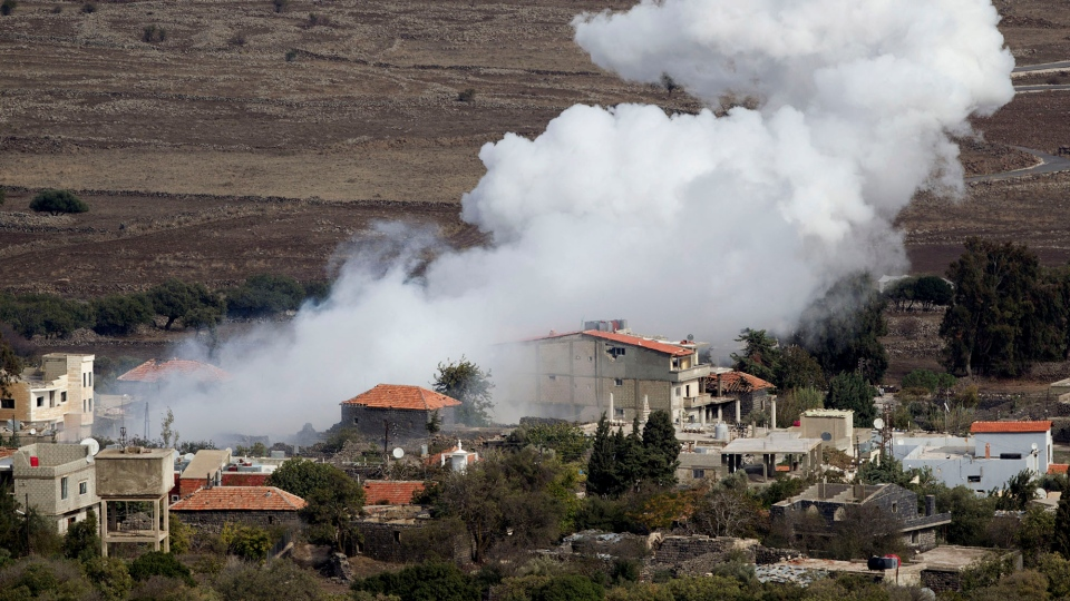 Smoke rises after shells exploded in the Syrian village of Bariqa, near the Israeli-Syrian border, near Alonei Habashan in the Golan Heights, Monday, Nov. 12, 2012. (AP / Ariel Schalit)