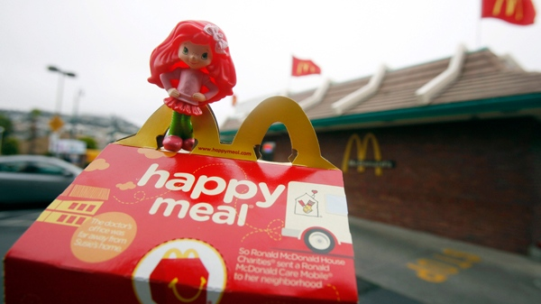 A Happy Meal box and toy are shown outside of a McDonald's restaurant in San Francisco. (AP / Jeff Chiu)