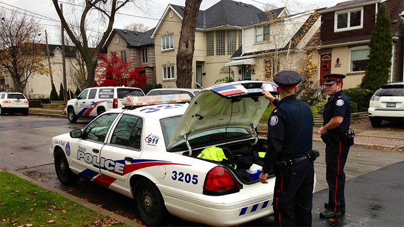 Police invesetigate on Woburn Avenue after two women were sexually assaulted by an armed intruder in Toronto on Nov. 12, 2012. (Tom Podolec / CTV Toronto)