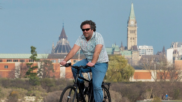 A man rides his bike along the Ottawa River in Ottawa, Monday, November 12, 2012. Temperatures in the region were above normal for this time of year with readings in the high teens. THE CANADIAN PRESS/Adrian Wyld