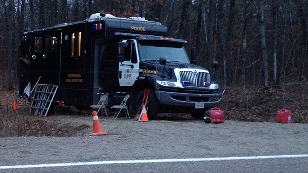 Ontario Provincial Police have set up a command post as they investigate human remains found in a wooded area near Calabogie on Nov. 11, 2012.