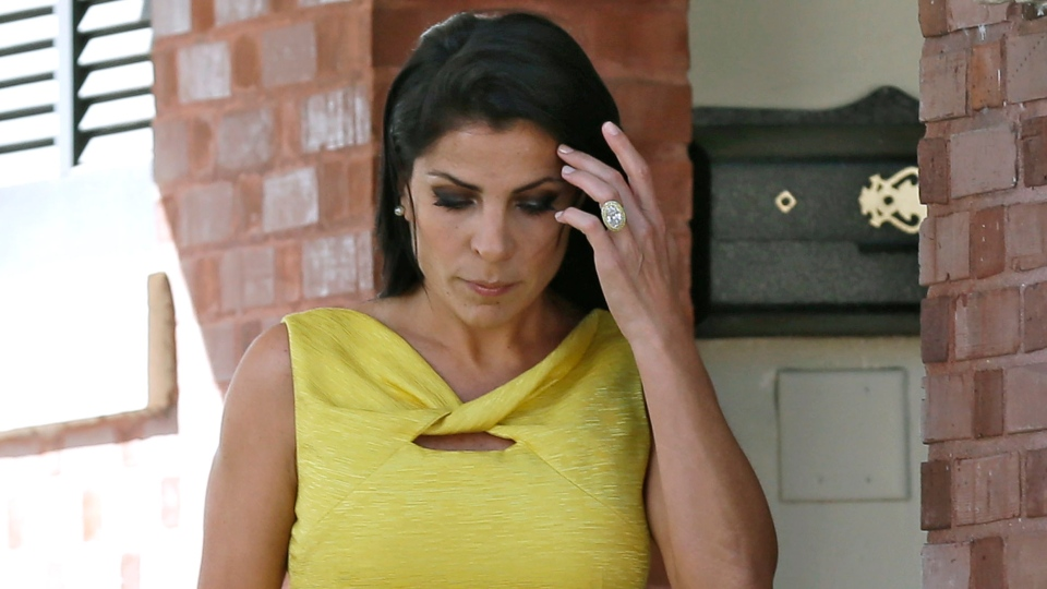 Jill Kelley leaves her home in Tampa, Fla., on Monday, Nov 12, 2012. (AP / Chris O'Meara)