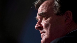 Finance Minister Jim Flaherty speaks with the media in the foyer of the House of Commons on Parliament Hill in Ottawa on Tuesday, Oct. 30, 2012. (Adrian Wyld / THE CANADIAN PRESS)