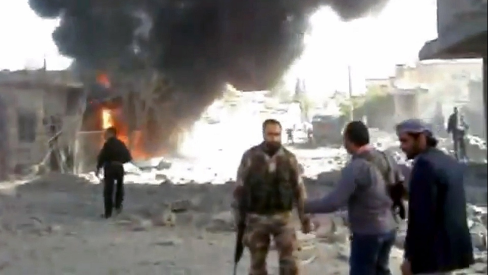 Syrians inspect the damage while looking for victims moments after an airstrike by Syrian warplanes in Ras al-Ayn, Syria, Monday, Nov. 12, 2012. (AP / Shaam News Network via AP video)