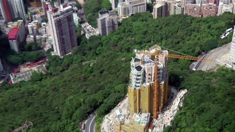 This image taken from video courtesy Swire Properties, 'Opus Hong Kong,' is seen under construction.