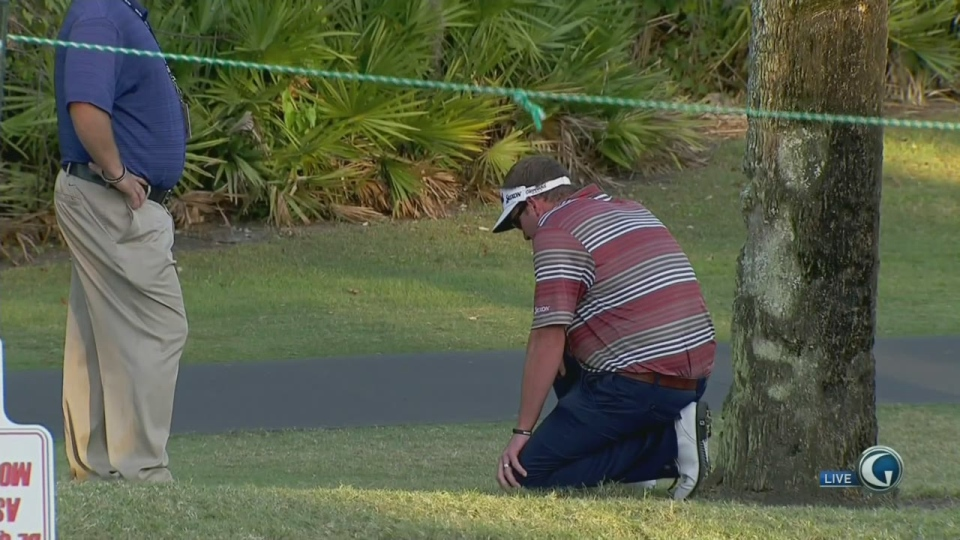 In this image taken from video, golfer Charlie Beljan experiences a panic attack during a PGA Tour event in Florida.