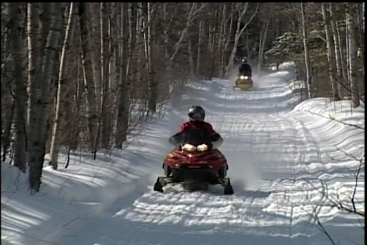 Snowmobilers in northern Saskatchewan