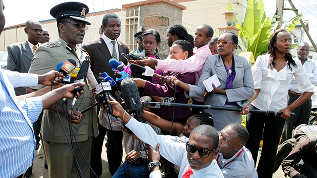 Kenyan Commissioner of Police Mathew Kirai Iteere, left, addresses media on the weekend attack on the police officers in Samburu, northwestern Kenya at Wilson Airport Nairobi, Kenya, Tuesday, Nov. 13, 2012. (AP / Sayyid Azim)
