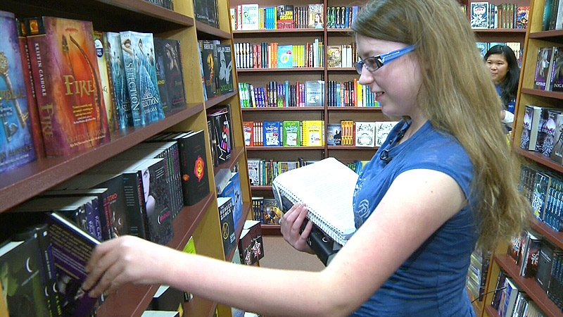 Rayvn Stevens, 13, at Chapters in West Edmonton Mall on Tuesday, November 13 - the 13-year-old cancer patient was given a book shopping spree from the Make a Wish Foundation.