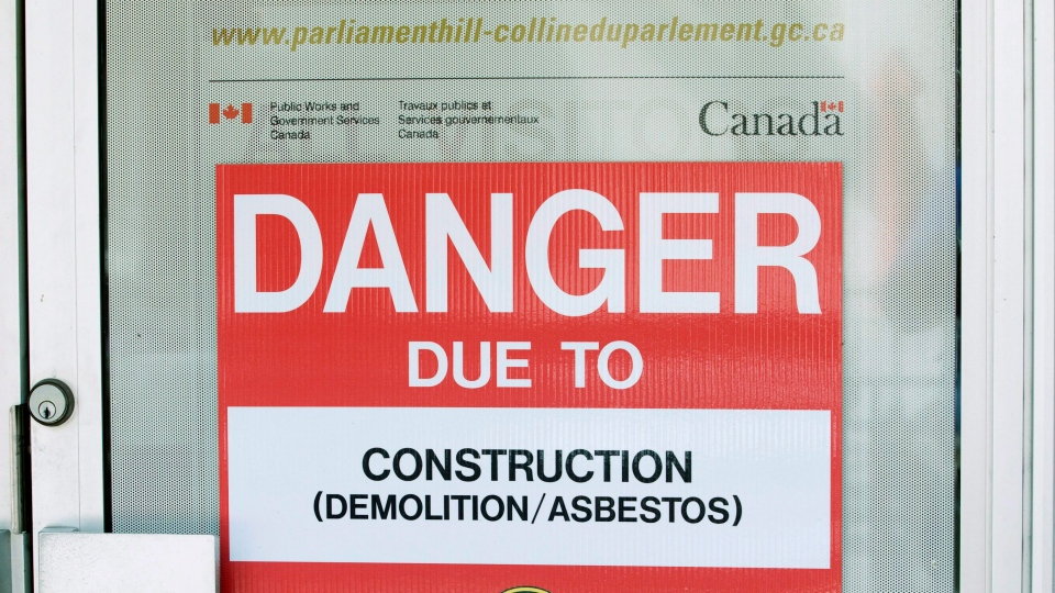 A danger sign is seen outside a construction zone in Ottawa on June 20, 2011. (Adrian Wyld / THE CANADIAN PRESS)