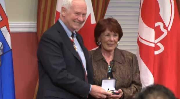 Colleen Klein is seen with Governor General David Johnston, accepting the Order of Canada award for her husband, former premier Ralph Klein.
