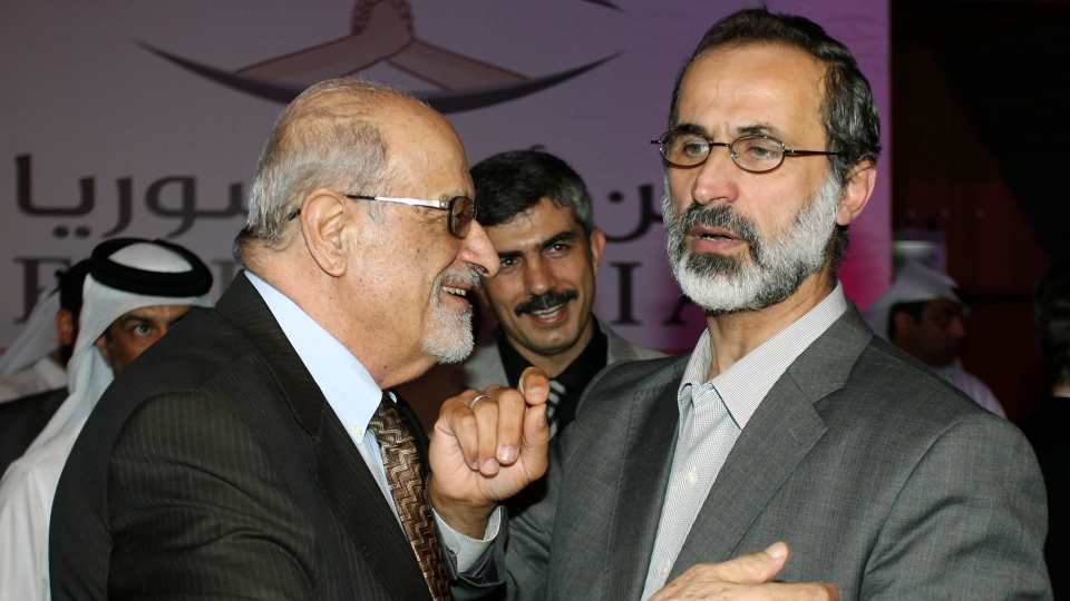Syrian opposition figure and prominent Syrian human rights activist Haytham al-Maleh, left, congratulates Muslim cleric Mouaz al-Khatib after he was elected president of the newly formed Syrian National Coalition for Opposition and Revolutionary Forces, in Doha, Qatar, Sunday, Nov. 11, 2012. (AP / Osama Faisal)