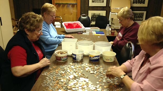Volunteers sort through the donations after the Royal Canadian Legion poppy drive in Brantford, Ont. on Tuesday, Nov. 13, 2012. (Art Baumunk / CTV Kitchener)