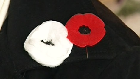The Royal Canadian Legion is mulling whether to launch a lawsuit if groups in Prince Edward Island and Ontario do not stop handing out white poppies ahead of Remembrance Day.