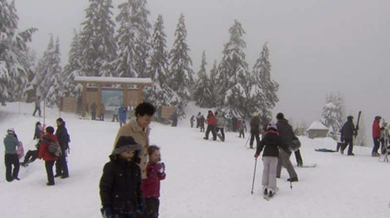Skiers and snowboarders gather on Grouse Mountain in this February 2012 file photo. (CTV)