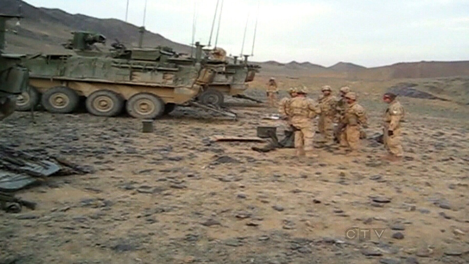 Canadian soldiers are seen on a training range outside of Kandahar City, after an anti-personnel mine exploded, killing Cpl. Josh Baker, in February of 2010.