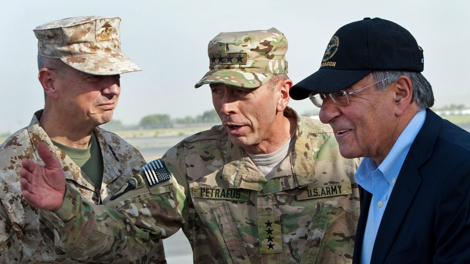 USMC Gen. John Allen, left, and Army Gen. David Petraeus, top U.S. commander in Afghanistan and incoming CIA Director, greet former CIA Director and new U.S. Defense Secretary Leon Panetta, right, as he lands in Kabul, Afghanistan, Saturday, July 9, 2011. (AP / Paul J. Richards)