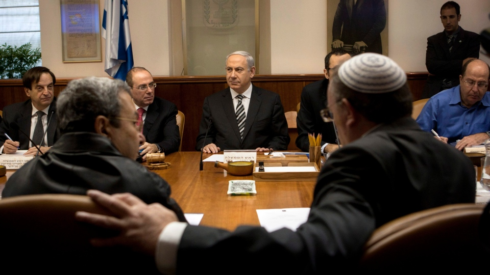 Israeli Prime Minister Benjamin Netanyahu, centre, together with Vice Prime Minister Silvan Shalom, second left, Deputy Prime Minister Dan Meridor, left, Cabinet Minister Moshe Yaalon, right, Israeli Defense Minister Ehud Barak, front row left, and Minister of Science and Technology Daniel Hershkowitz, attend the weekly cabinet Jerusalem, Sunday, Nov. 11, 2012. (AP / Sebastian Scheiner)