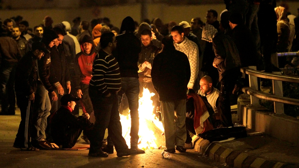 In this photo taken late Tuesday, Nov. 13, 2012, protesters take part in a demonstration following an announcement that Jordan would raise fuel prices, including a hike on cooking gas, in Amman, Jordan. (AP Photo/Raad Adayleh)