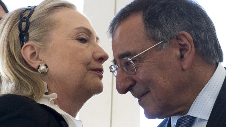U.S. Secretary of State Hillary Rodham Clinton, left, whispers to Secretary of Defense Leon Panetta during a reception hosted by Colin Barnett, Premier of Western Australia, at the Indiana Teahouse at Cottesloe Beach near Perth, Australia, on Wednesday, Nov. 14, 2012. (AP Photo/Saul Loeb, Pool)
