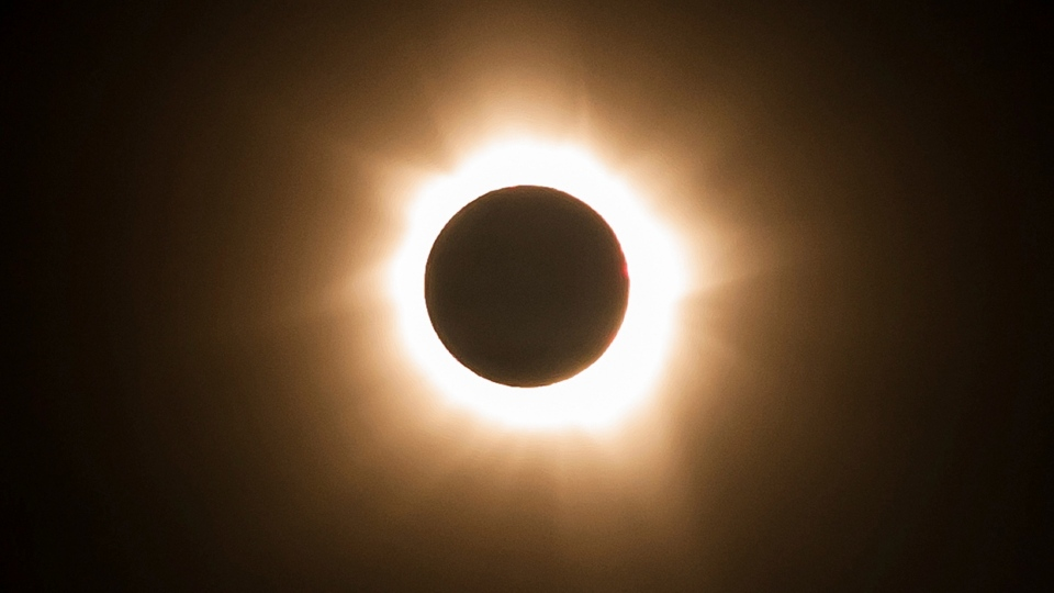 In this photo provided by Tourism Queensland, the moment of a total solar eclipse is observed at Cape Tribulation in Queensland state, Australia, Wednesday, Nov. 14, 2012. (Tourism Queensland)
